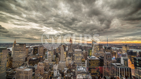 Empire State Building and Manhattan cityscape with beautiful cloud pattern overhead at sunset in early evening