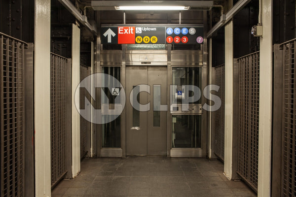 subway station elevator at Times Square with all lines on sign
