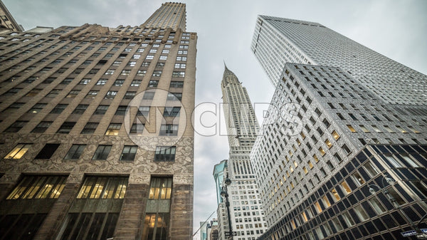Chrysler Building in Midtown Manhattan - upward angle in early evening on summer day