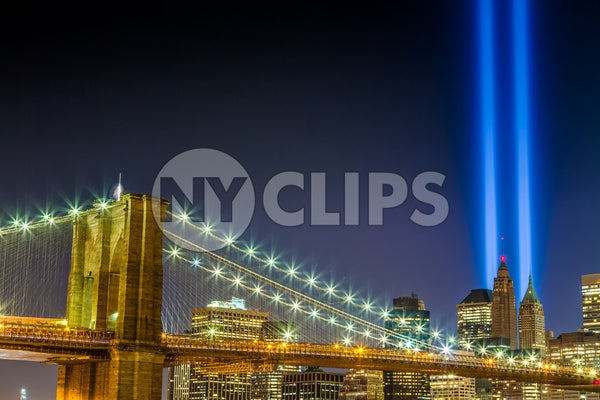 911 lights over Manhattan and Brooklyn Bridge at night