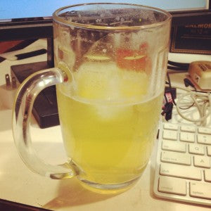 A beer and lemonade concoction sits on Marc's desk.