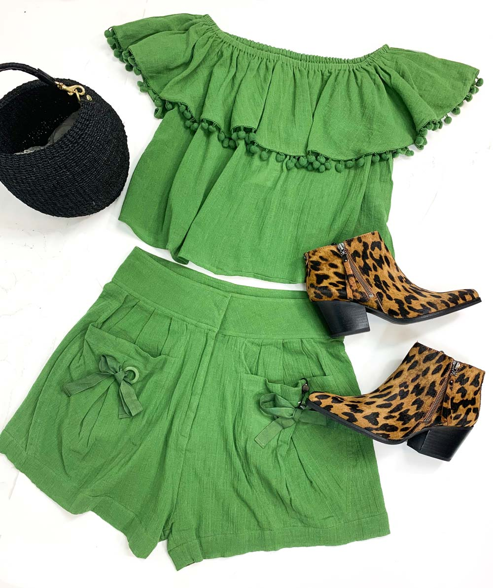 Shop Laurence Bras Green Shorts and Green Off Shoulder Crop Top with Poms, all green outfit ideas, st. patricks day outfit womens, clarev black basket bag, green designer top clearance