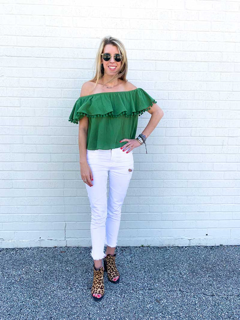 off the shoulder green Laurence Brass top and distressed white denim pants with rag and bone booties