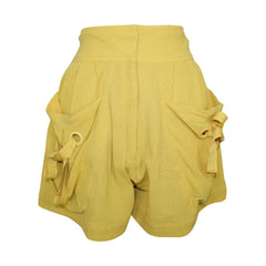 Shop Laurence Bras online on sale at Muse Boutique Outlet | Laurence Bras Cotton Relaxed Fit Shorts | Shop yellow summer shorts on sale, discounted designer summer shorts on sale, high waisted yellow shorts on sale