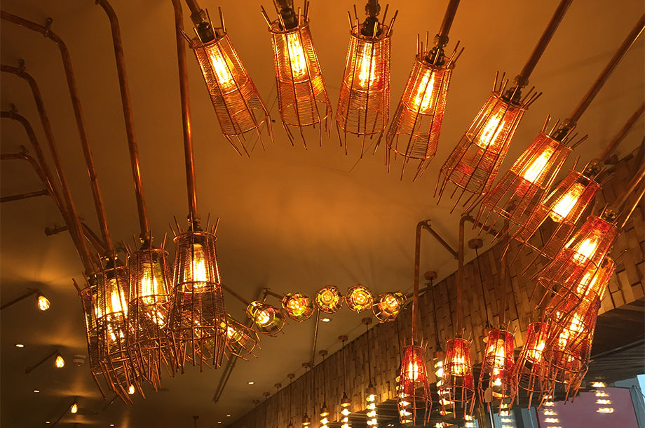 Nando's Hove has Bright Goods LED filament lamps in quirky metal cage light fittings
