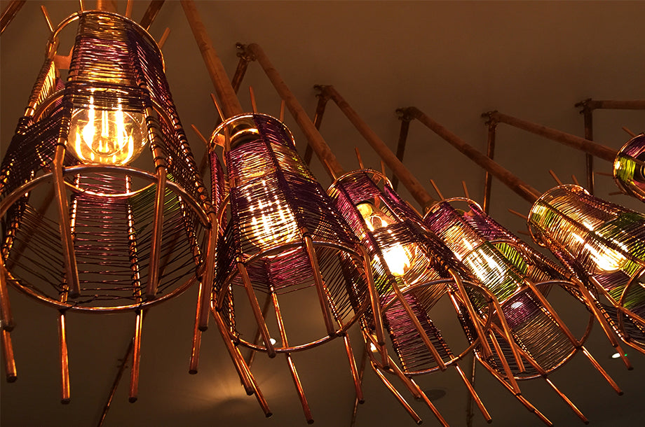 Nando's Hove has Bright Goods LED filament lamps in quirky metal cage light fittings close up