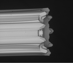SEM high resolution image of the multi-nozzle emitter with nine independent channels. Each channel is 10 micrometers, which is approximately 1/10th the diameter of the average human hair.