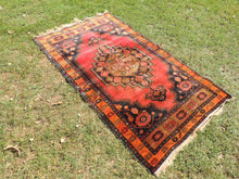 1950's Authentic Turkish Rug Red Background