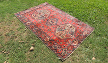 Geometric Caucasian Area Rug with Red Background