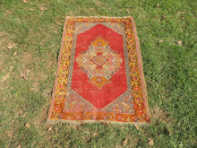 Worn Turkish area rug