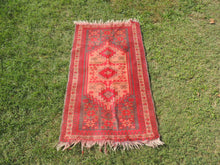 small red turkish area rug