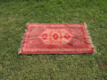 small red turkish carpet