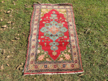Red and turquoise Turkish carpet on sale