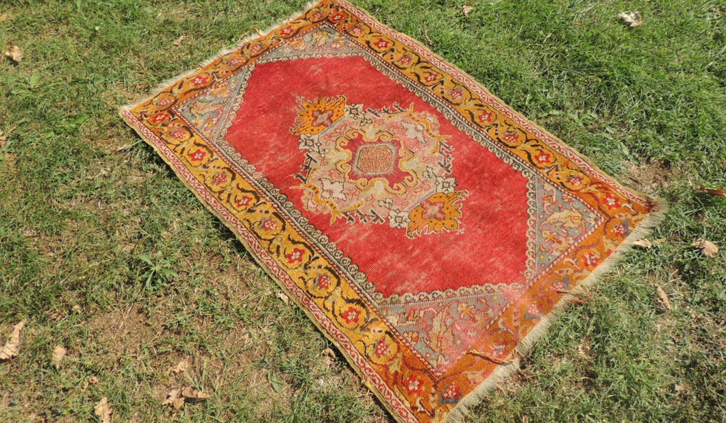 1960's Worn Turkish Area Rug with Gold Color Borders