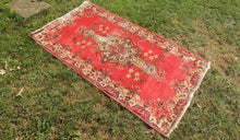 Red Turkish Area Rug with Distressed Center