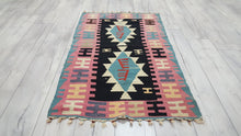 Turkish Kilim Rug Baby Blue and Baby Pink on Black Background
