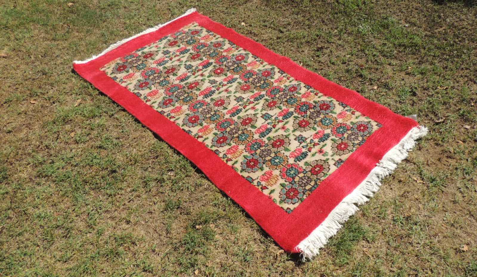 vintage turkish area rug with lovely floral patterns and red borders