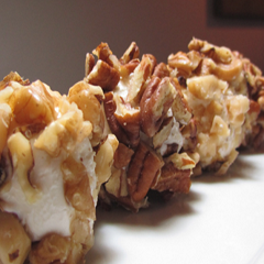 Cream cheese balls wrapped in toasted hazelnuts Recipe