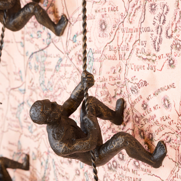 Iron Wall Climber Sculpture