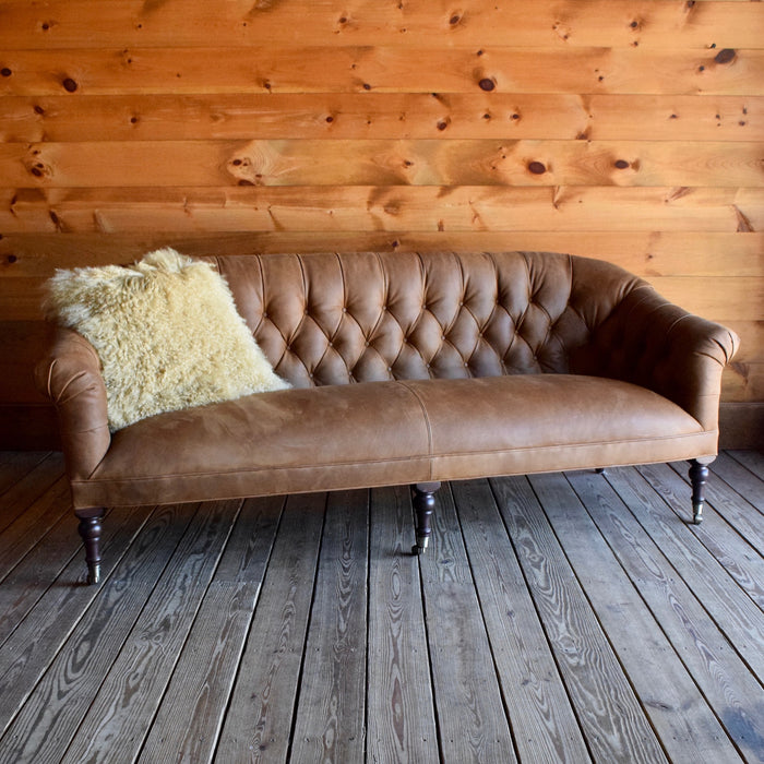 Leather Chesterfield Tufted Sofa with Vintage Chestnut legs on Casters