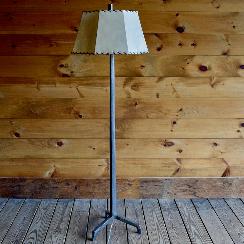 Tapered Rustic Cast Iron Floor Lamp with Raw Steel Finish and Laced Rawhide Shade