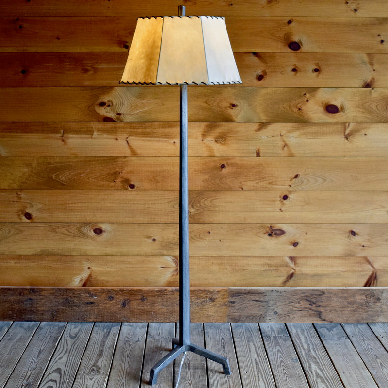 Tapered Cast Iron Floor Lamp with Raw Steel Finish and Laced Rawhide Shade