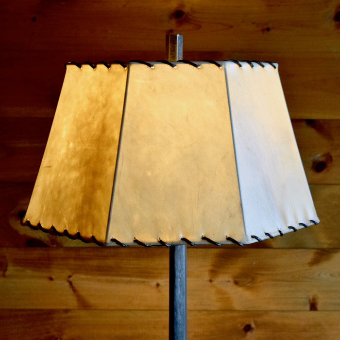 Tapered Industrial Cast Iron Floor Lamp with Raw Steel Finish and Laced Rawhide Shade