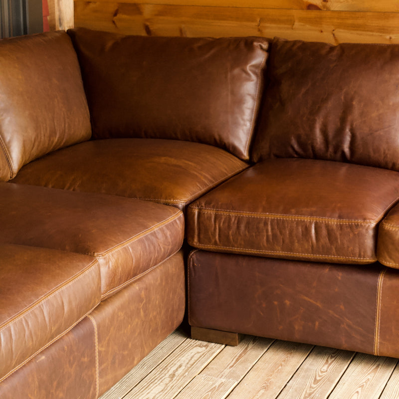 Rustic Leather Sectional with Wide Track Arms
