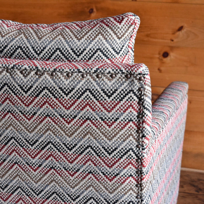 Rustic Arm Chair Upholstered in Striped Red Chevron with Track Arms and Nailhead Trim