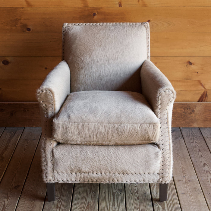 Rustic Arm Chair & Ottoman Upholstered in Cowhide Leather with Tack Trim