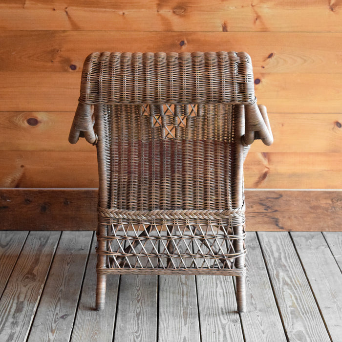 Natural Wicker Arm Chair with Swooping Back and Red Cushion