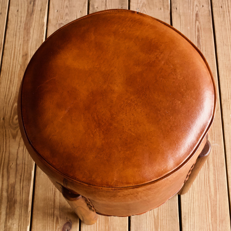 Rustic and Round Leather Ottoman with Daisy Nail Trim