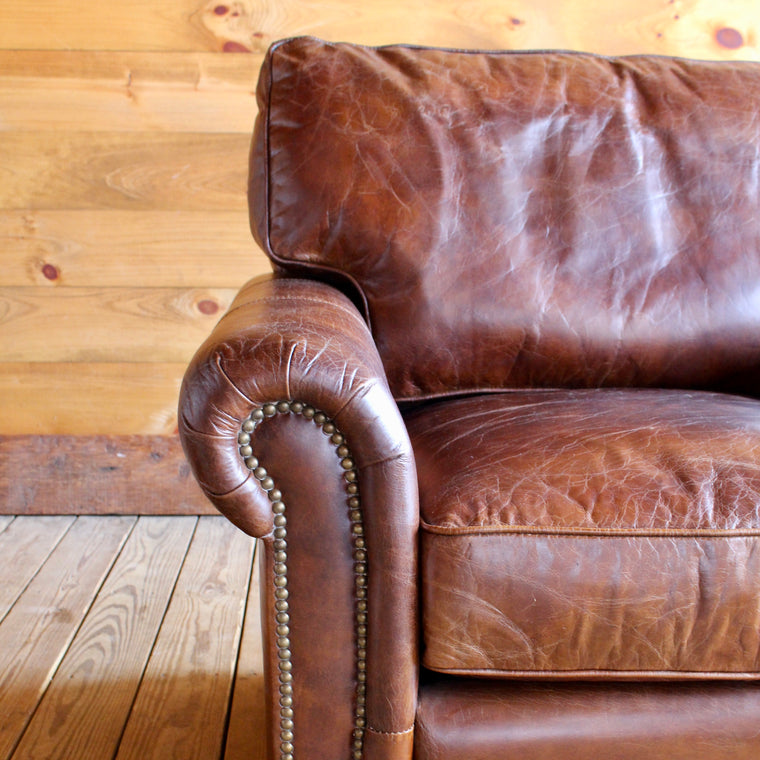 vintage cigar leather roll arm chair