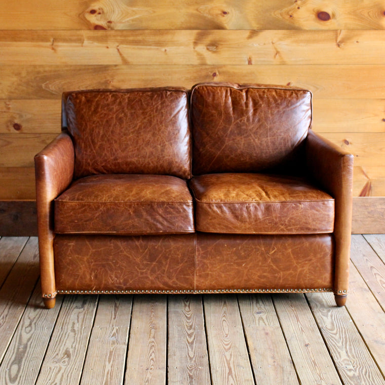 Leather Loveseat with Nail Head Trim