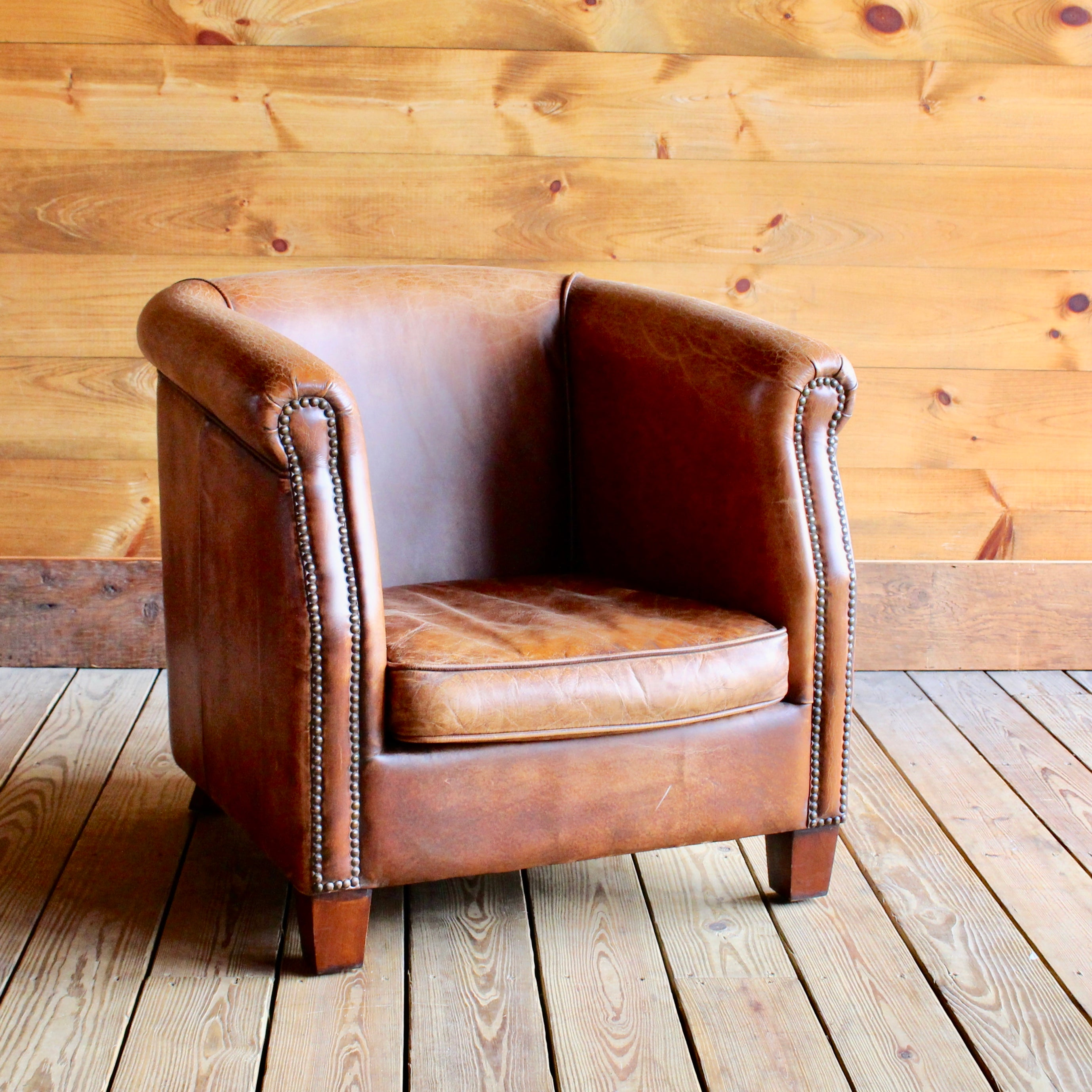 Charming Distressed Buffalo Leather Barrel Chair With Nailhead Trim