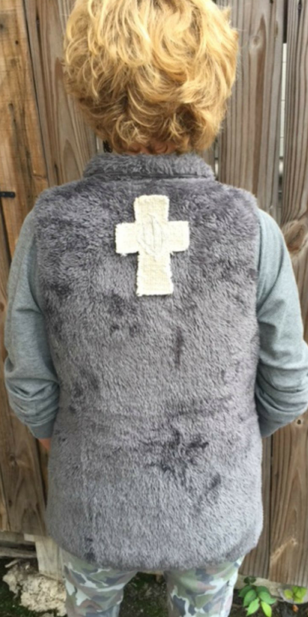 FUR VEST W CROSS