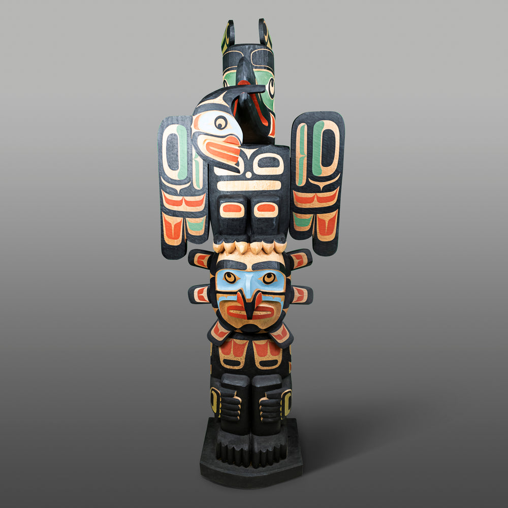 Raven and Sun Totem Pole by Calvin Hunt