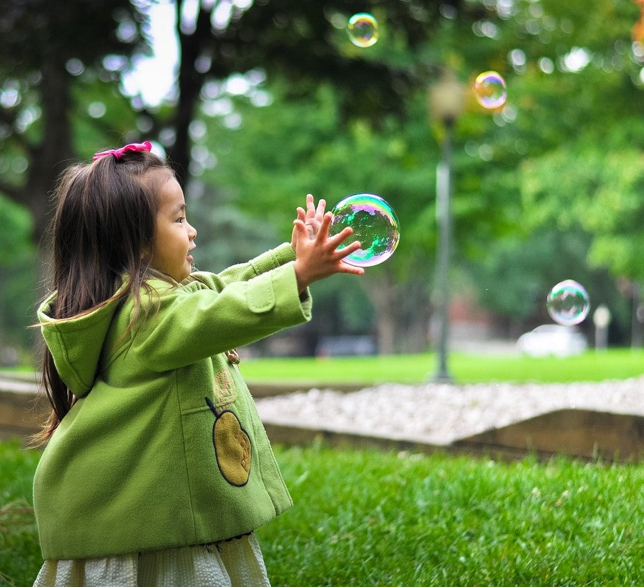 kid playing with bubbles | Yellow Scope