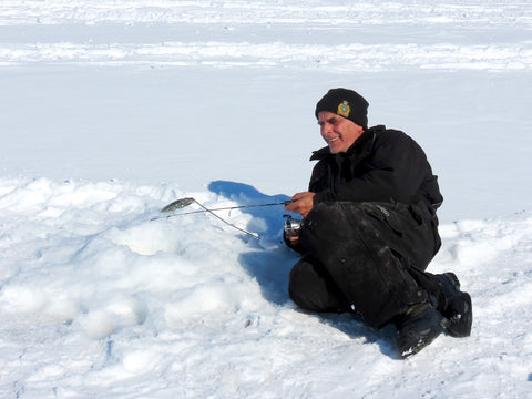 Laying on Ice while fishing