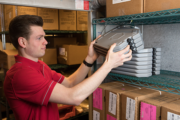 Nathan stacks IcePlates in the freezer for the team (Chick-Fil-A Scottsdale 101)