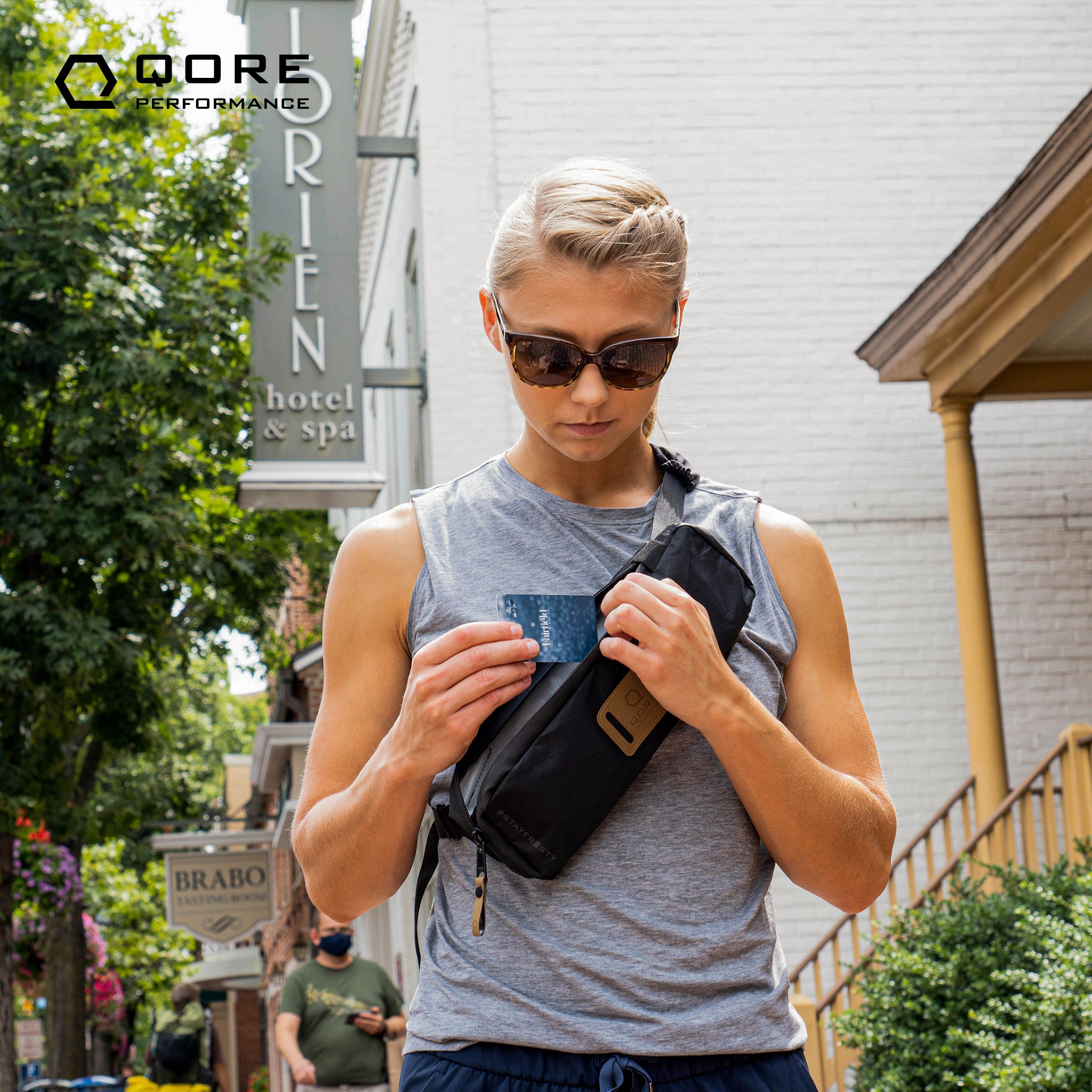 EDC Travel Sling by Qore Performance for walking, hiking, travel, every day carry, bike riding can carry a Taser Pulse, Glock 43, Sig Sauer P365, or Pepper Spray