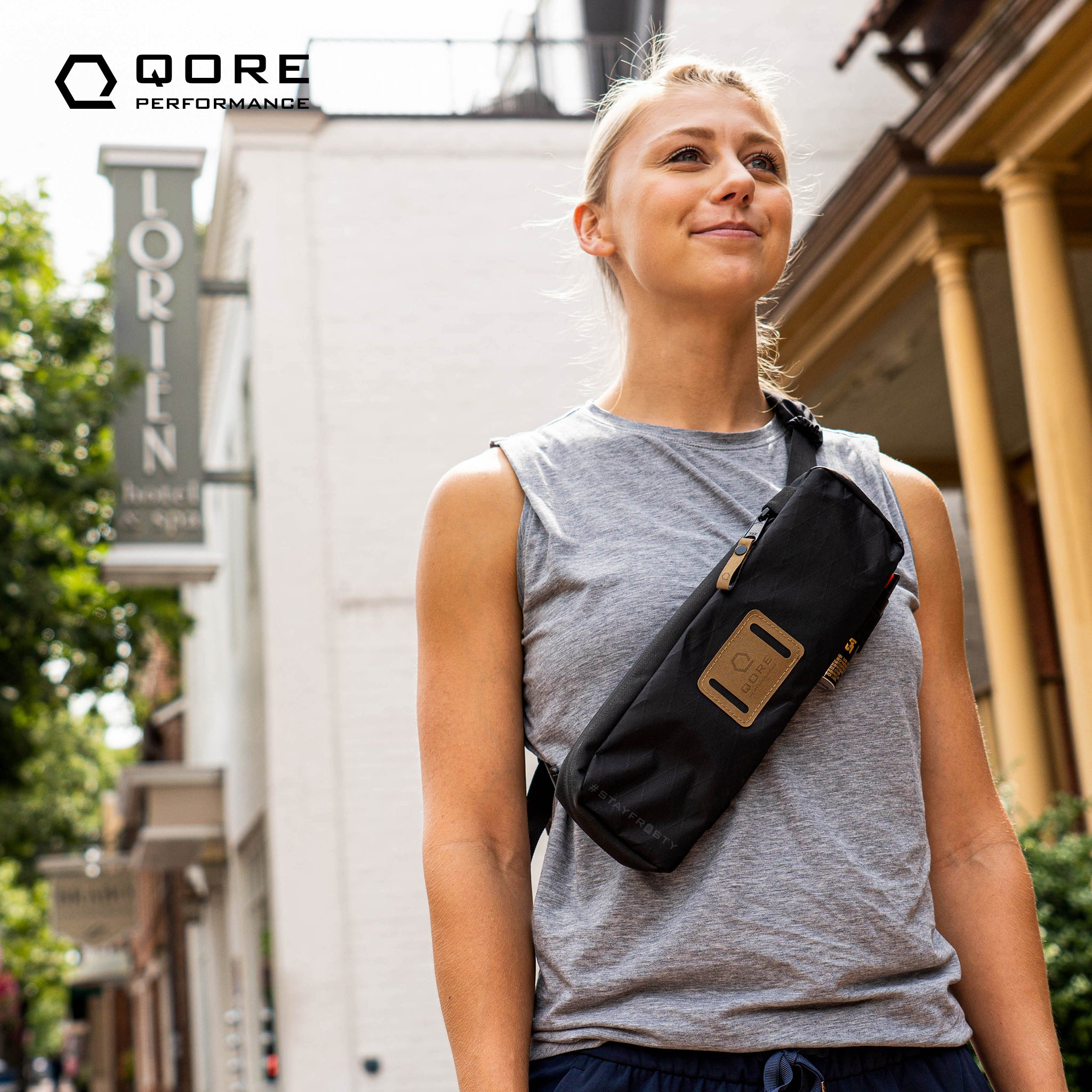 EDC Travel Sling by Qore Performance for walking, hiking, travel, every day carry, bike riding can carry a Taser Pulse, Glock 43, Sig Sauer P365, or Pepper Spray, hand-free hydration