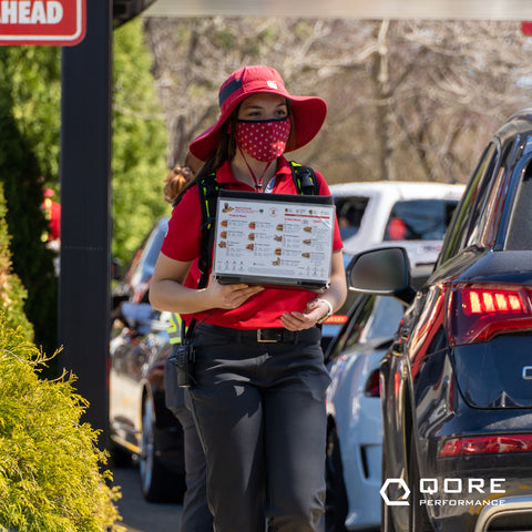 Chick-fil-A drive thru team members use IcePlate HiVis Backpack and IceCase iPad Cooling to maximize drive thru productivity