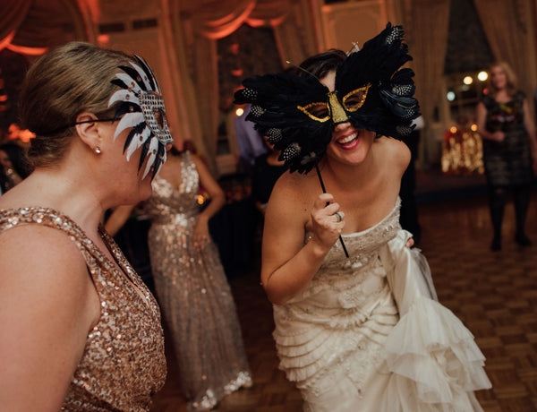 feather masks at art deco wedding reception
