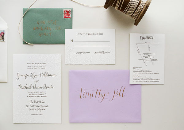 Modern gold green and lavender spanish inspired wedding invitations