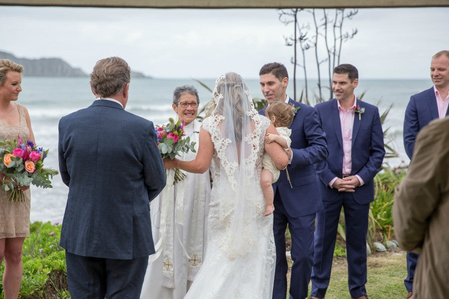 new zealand wedding bride and groom exchanging vows