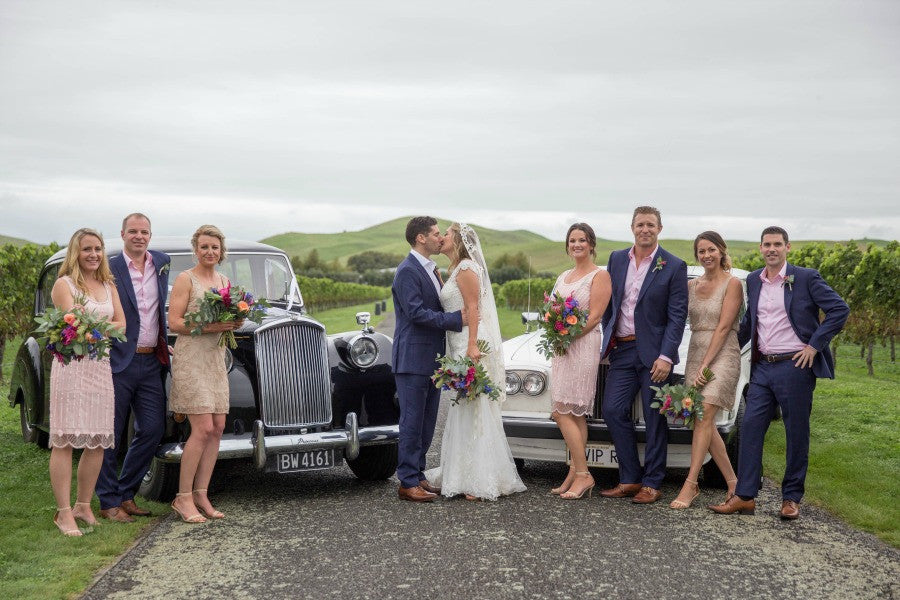 bridal party with vintage cars new zealand wedding