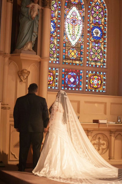 bride in cathedral mantilla veil with polka dots at church wedding
