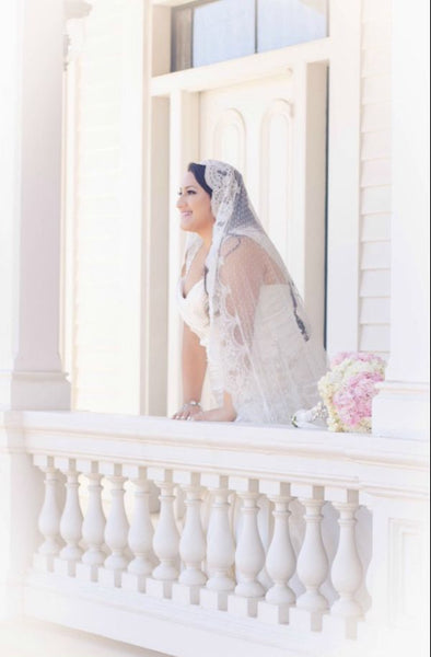 bride in polka dot mantilla veil