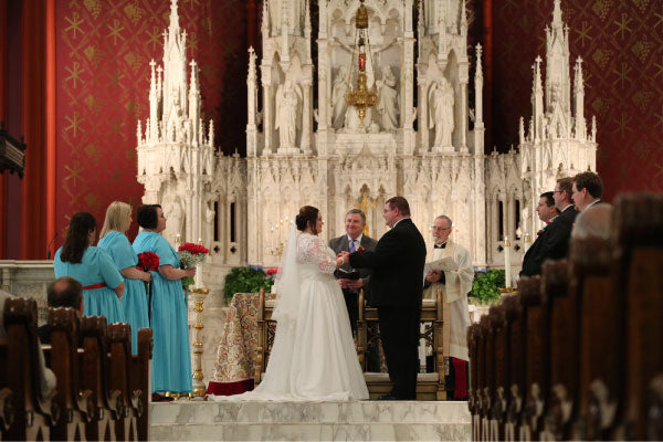 cathedral wedding in catholic church bride and groom